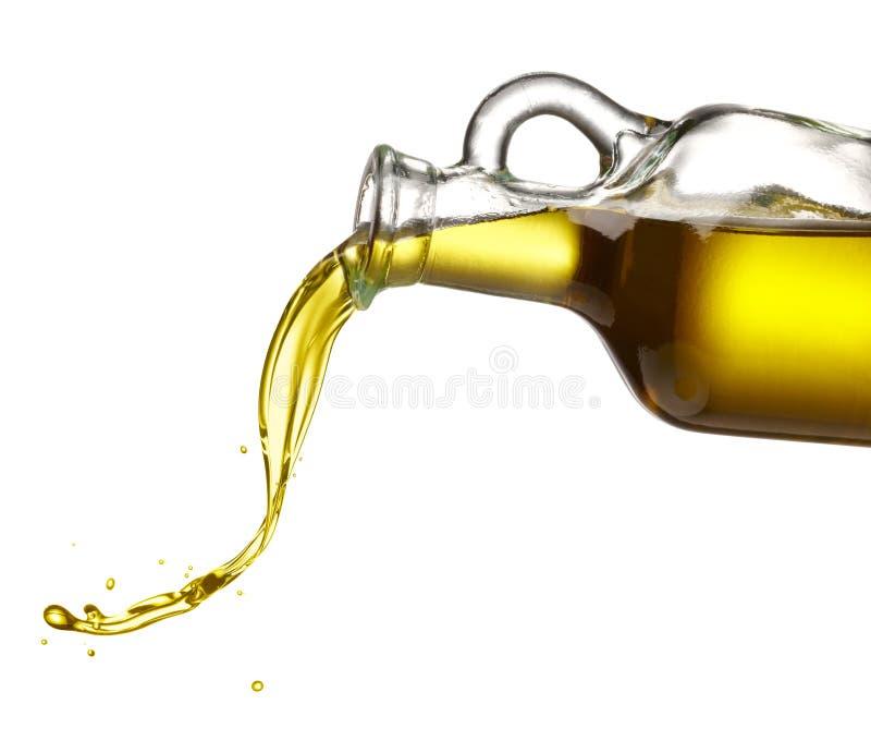 Auslaufendes Olivenöl lizenzfreie stockfotografie