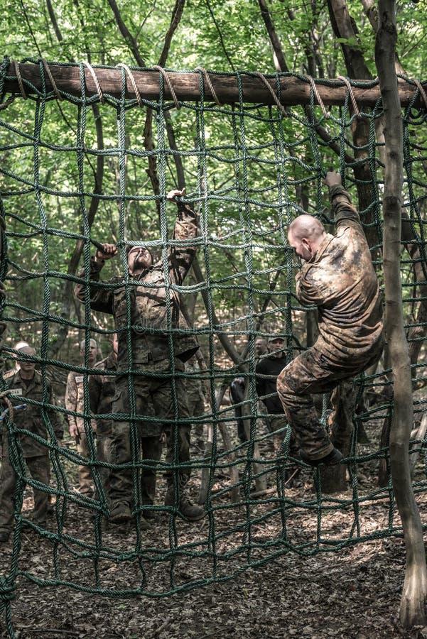 Auslese-Herausforderung - militärische Ausbildung, Wettbewerbszivilisten lizenzfreie stockbilder