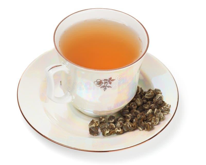 Auslese oolong Tee im Porzellancup lizenzfreie stockfotos