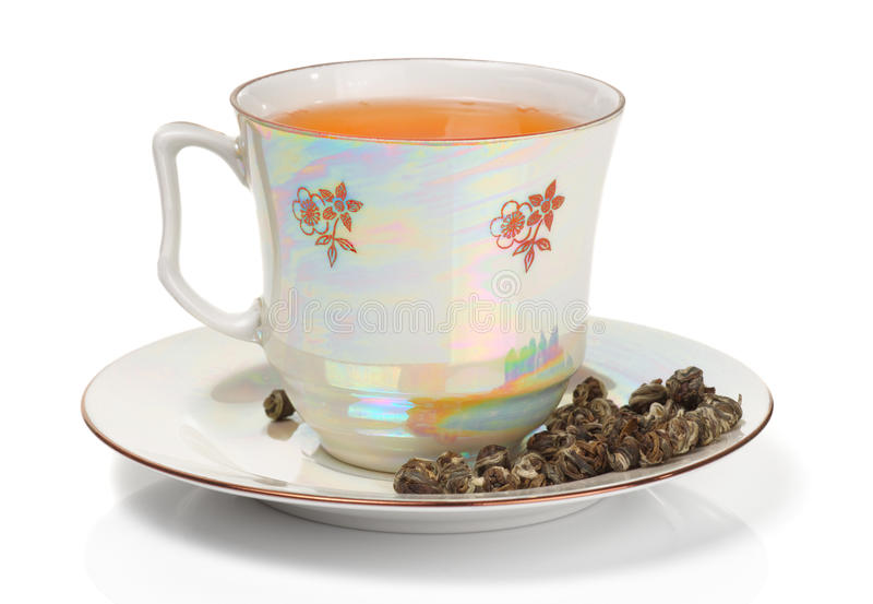 Auslese oolong Tee im Porzellancup lizenzfreie stockbilder