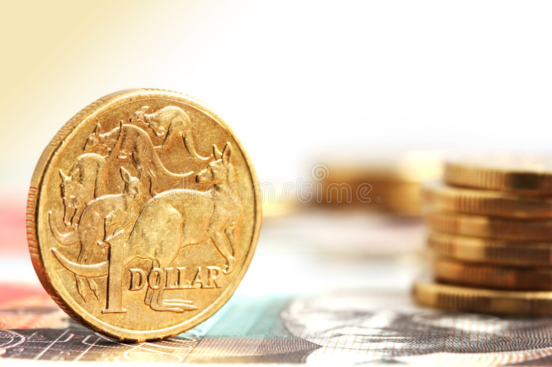 Aussie One Dollar Coins. On a twenty dollar note stock images