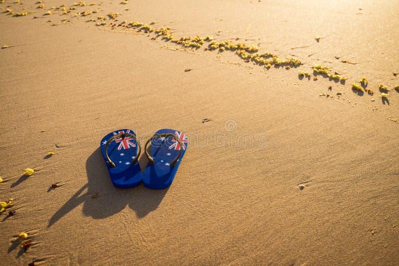 Aussie paski na plaży przy zmierzchem fotografia royalty free