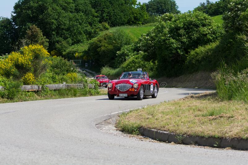 AUSTIN HEALEY 100/4 BN2 1956 on an old racing car in rally Mille Miglia 2018 the famous italian historical race 1927-1957. PESARO COLLE SAN BARTOLO , ITALY - MAY stock photography