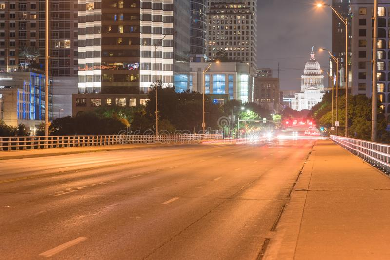 Austin modern skylines and state capitol building at night. Downtown Austin at night with traffic light trail lead to Texas State capitol building. View from royalty free stock photography