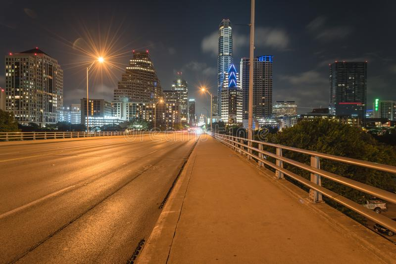 Austin modern skylines and state capitol building at night. Downtown Austin at night with traffic light trail lead to Texas State capitol building. View from royalty free stock photo
