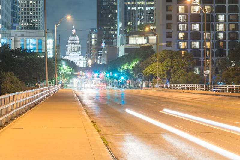 Austin modern skylines and state capitol building at night. Downtown Austin at night with traffic light trail lead to Texas State capitol building. View from stock images