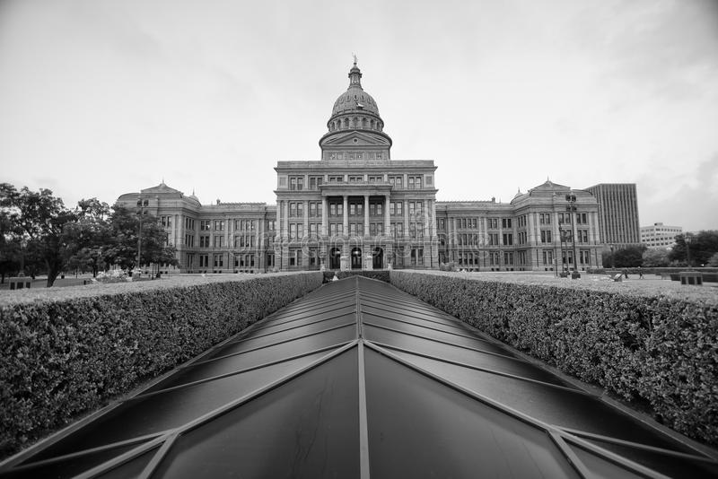 Austin State Capitol Building. In black and white with a sunroof and shrubbery in the foreground royalty free stock photo