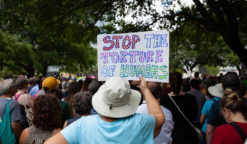 AUSTIN, TEXAS - JULY 2, 2019 - People protesting against President Donald Trump and border camps. Different demands written on. Pancards stock photos
