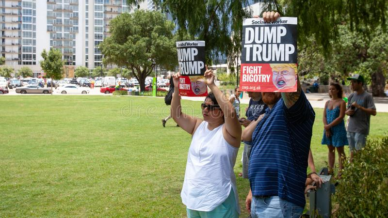 AUSTIN, TEXAS - JULY 2, 2019 - People protesting against President Donald Trump and border camps. Different demands written on. Pancards royalty free stock image