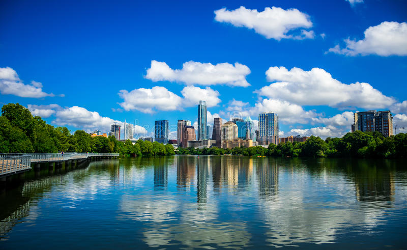 Austin Texas Riverside Pedestrian Bridge Town Lake Reflections on nice Summy Day. Austin Texas Colorful Towers and Condominiums Cityscape Skyline from stock images