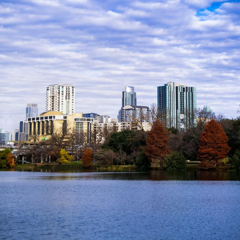 Austin, Texas Skyline in Fall from shores of Lady Bird Lake. Photo looking at the Austin, Texas skyline and changing Fall leaves from the shores of Lady Bird royalty free stock photos