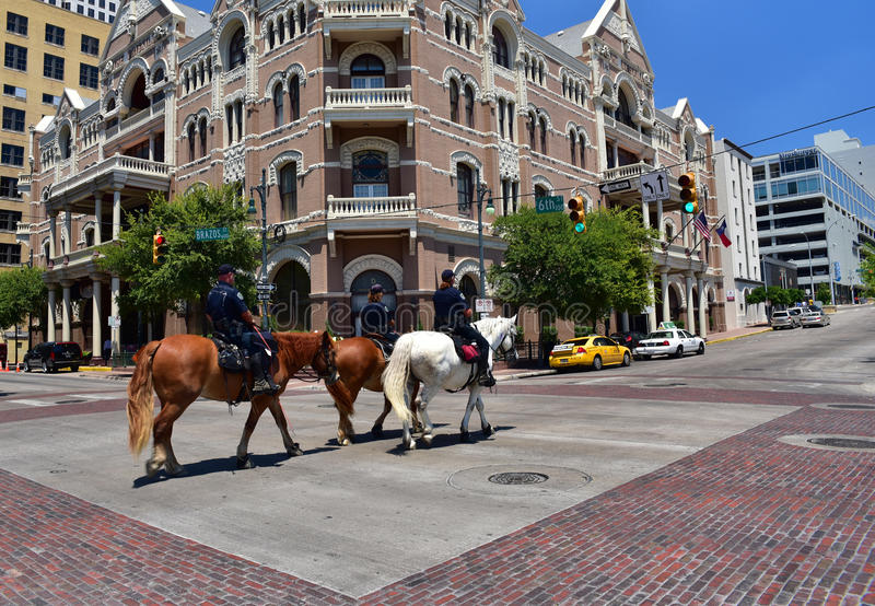 Austin.Texas in United States of America - August 2015.Three pol. Icemen on horseback patrolling the sixth street.Two policewomen and one policeman.Editorial royalty free stock photo