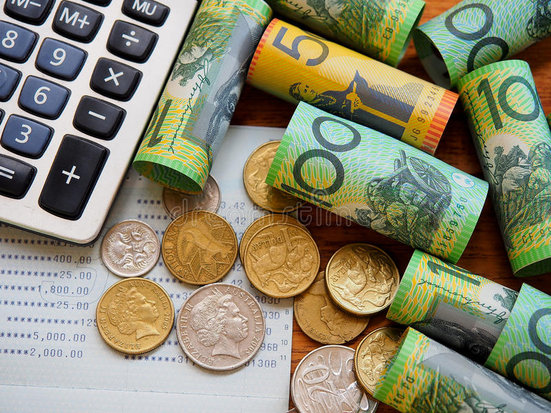Australia bank note and coins. Australia bank note,coins,account book and calculator in top view stock images