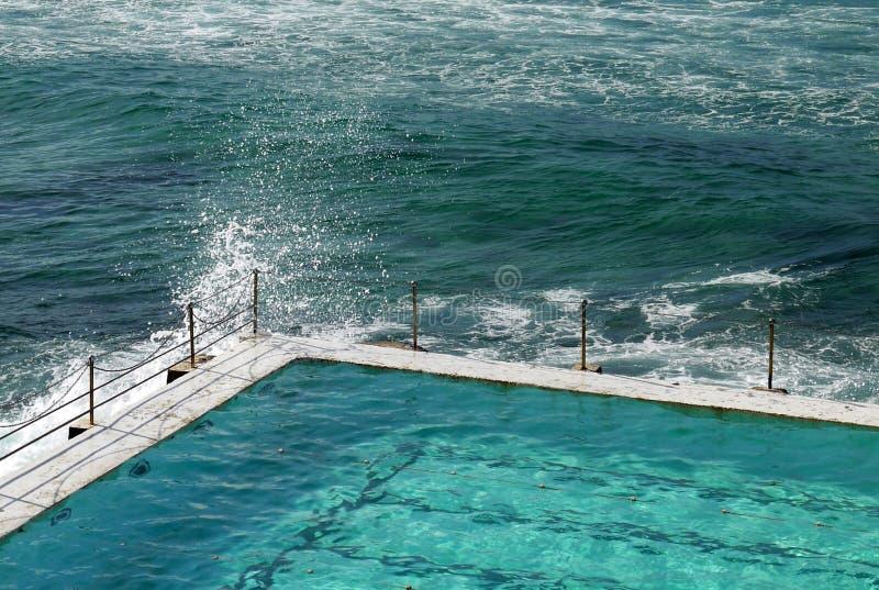 Australia: Bondi swimming pool and breaking wave royalty free stock images