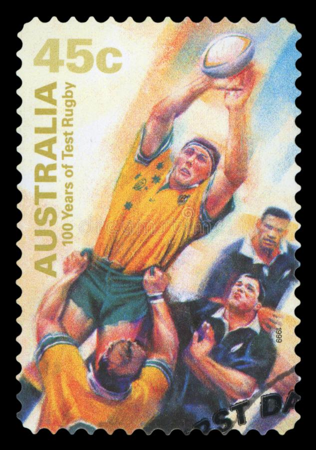 AUSTRALIA - Postage stamp. AUSTRALIA - CIRCA 1999: A Stamp printed in AUSTRALIA shows the Catching ball, 100 Years of Test Rugby, series, circa 1999. Isolated on stock photos