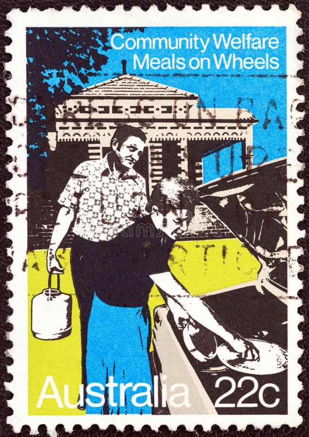 AUSTRALIA - CIRCA 1980: A stamp printed in Australia shows meals on wheels, circa 1980. AUSTRALIA - CIRCA 1980: A stamp printed in Australia from the `Community royalty free stock images