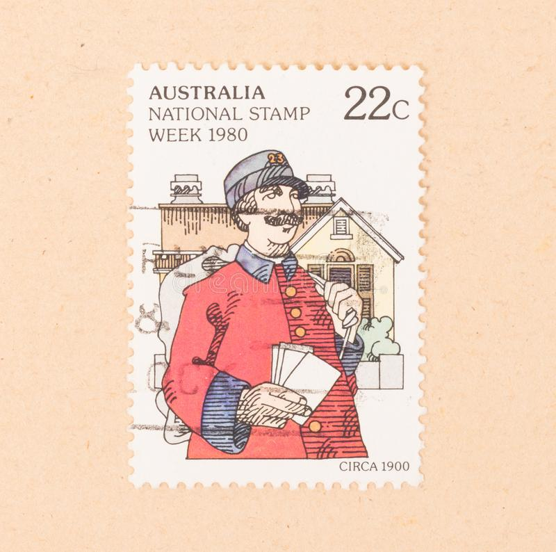 A stamp printed in Australia shows a mail man, circa 1980. AUSTRALIA - CIRCA 1980: A stamp printed in Australia shows a mail man, circa 1980 stock photos