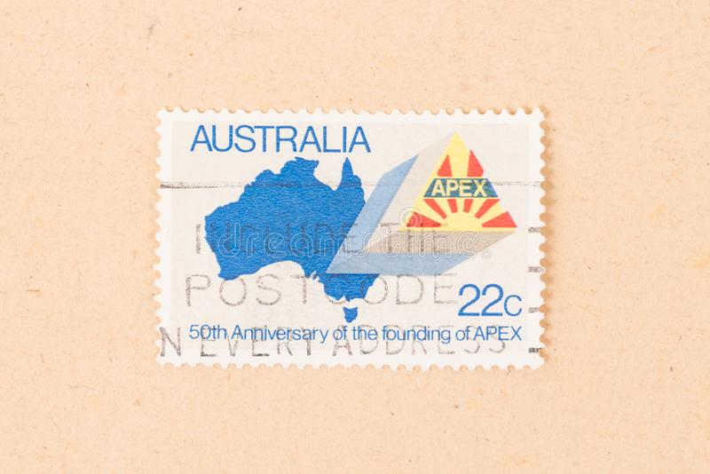 A stamp printed in Australia shows the 50th anniversary of the founding of APEX, circa 1980. AUSTRALIA - CIRCA 1980: A stamp printed in Australia shows the 50th stock images