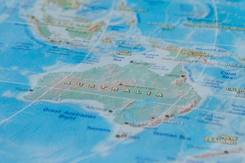Australia in close up on the map. Focus on the name of country. Vignetting effect vector illustration