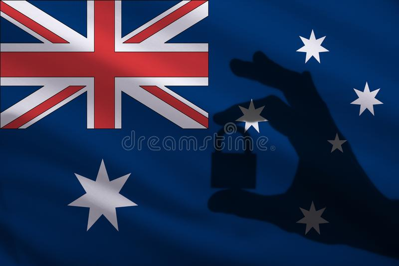 Australia closed lock in the hand. Import and export of goods from the world market of trade is prohibited. Closed borders. For tourists and immigrants royalty free illustration