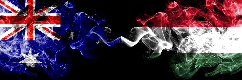 Australia contra Hungría, banderas místicas ahumadas húngaras colocadas de lado a lado Grueso coloreado sedoso fuma la combinació foto de archivo libre de regalías