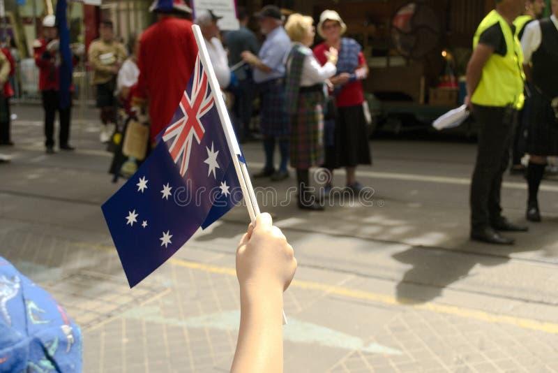 Australia Day in Melbourne - January 26, 2019. Child waving Australian Flag stock photo