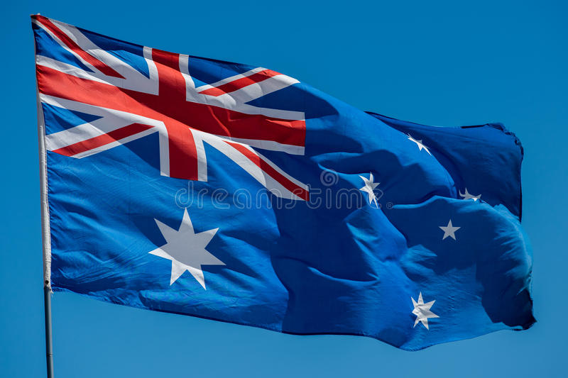 australia flag while waving royalty free stock images