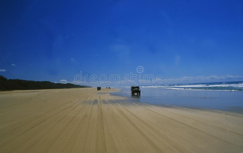 Australia: Fraser Island Beach. Australia: Offroad-traffic on Fraser Island beach, where also small airplaines are landing stock photos