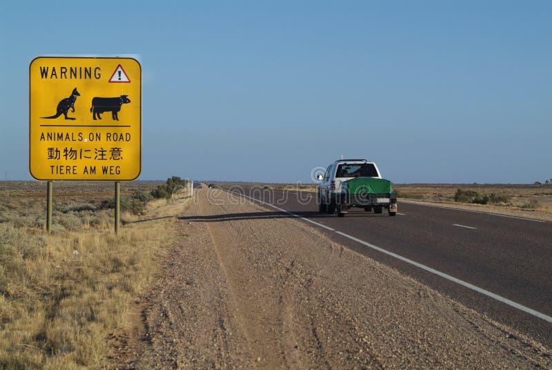 Australia, Highway. Australia, warning sign on 3300 km long Stuart Highway from Adelaide to Darwin stock photography