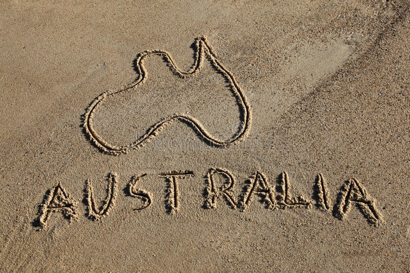 Australia map. And word drawn in the sand at the beach. Australia's beaches are one of its iconic drawcards stock image