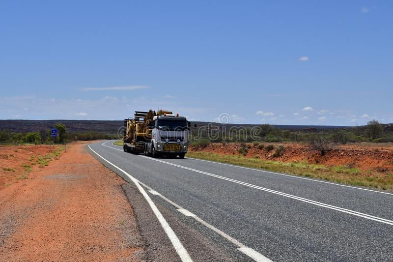 Australia, Transport, Industry. Australia, Northern Territory - November 15, 2017: Heavy oversize transport with truck named Road Train on Stuart Highway royalty free stock photos