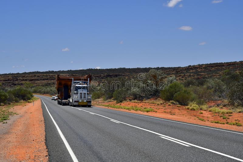Australia, Traffic, Transport. Australia, Northern Territory - November 15, 2017: Heavy oversize transport with truck named Road Train on Stuart Highway stock images