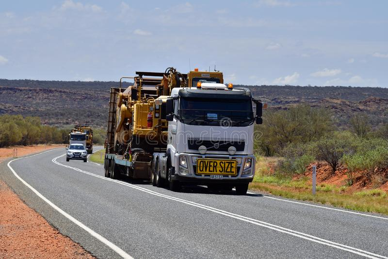 Australia, Transport, Industry. Australia, Northern Territory - November 15, 2017: Heavy oversize transport with two trucks named Road Train on Stuart Highway royalty free stock photography