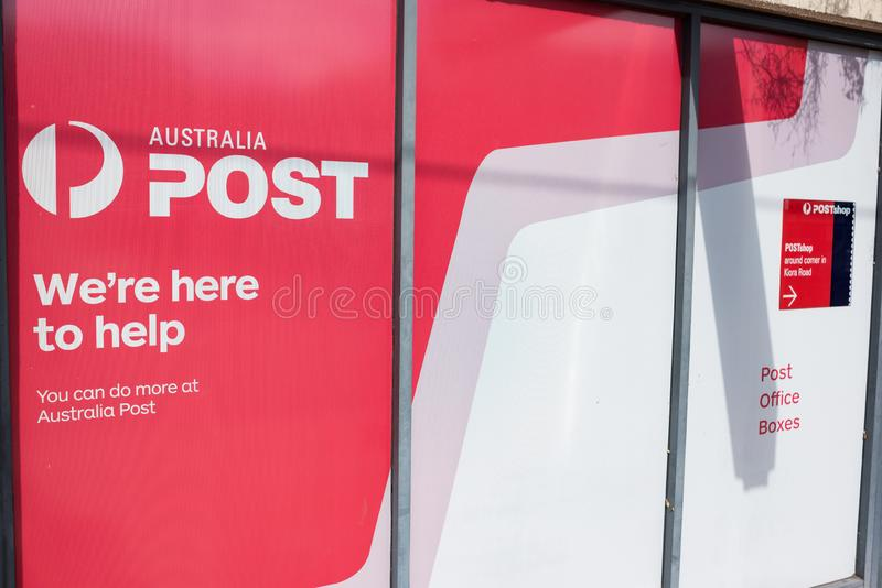 Australia Post post office boxes and shop advertisement sign royalty free stock photography
