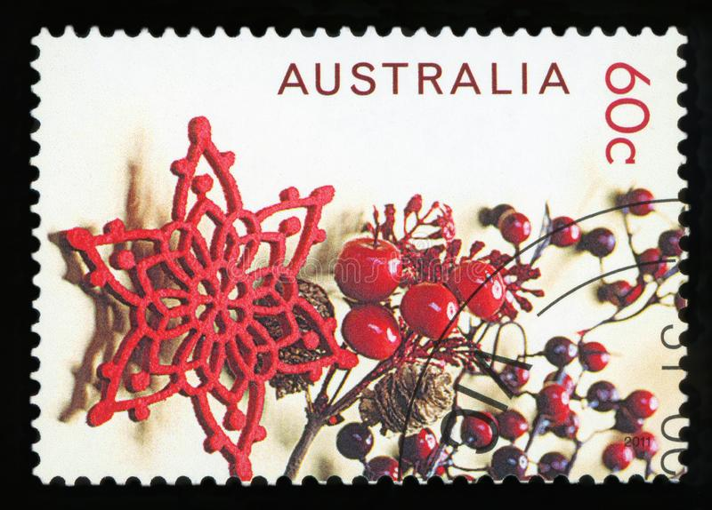 AUSTRALIA - postage stamp. AUSTRALIA - CIRCA 2011: A Cancelled postage stamp from Australia shows Christmas decorations, issued in 2011 stock photography