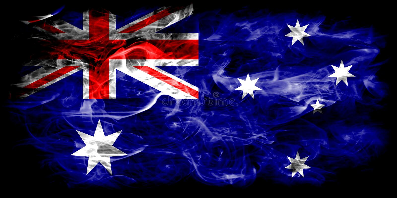 Australia smoke flag on a black background stock photography