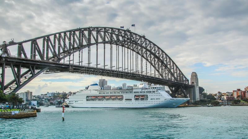 Cruise shipping under the Sydney Harbour Bridge royalty free stock photos