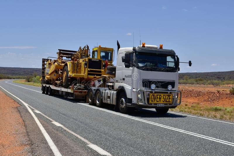 Australia, Transport, Industry. Australia, Northern Territory - November 15, 2017: Heavy oversize transport with truck named Road Train on Stuart Highway stock photography