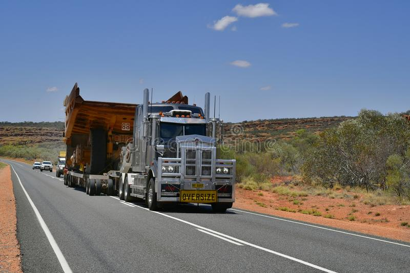 Australia, Transport, Industry, Truck. Australia, Northern Territory - November 15, 2017: Heavy oversize transport with truck named Road Train on Stuart Highway royalty free stock images