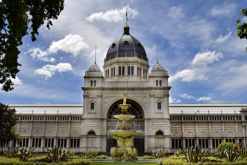 Australia, Victoria, Melbourne, Carlton Gardens. Melbourne, VIC, Australia - November 05, 2017: Royal Exhibition Building and fountain in public Carlton Gardens royalty free stock photography