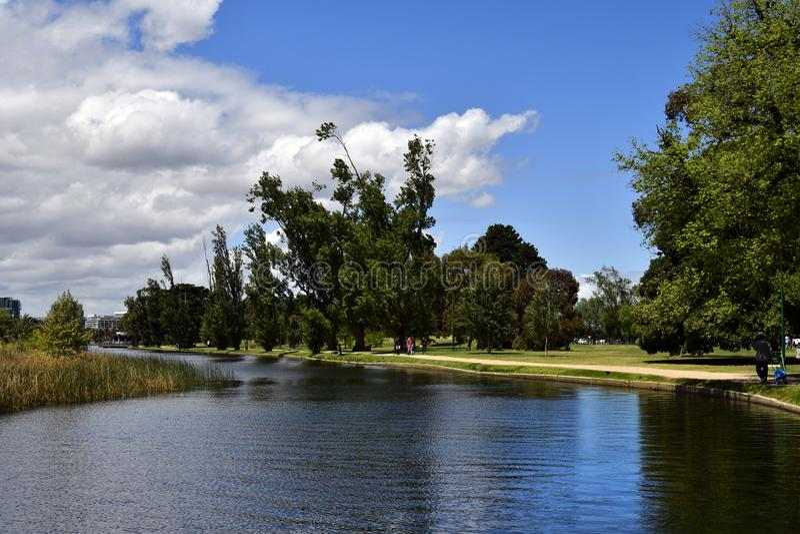 Australia, Victoria, Melbourne, Albert Park. Melbourne, VIC, Australia - November 04, 2017: Unidentified people in Albert Park with Albert Park Lake royalty free stock photo