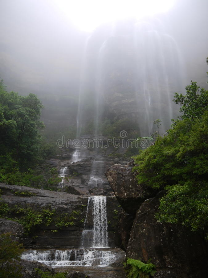 Australia: Blue Mountains waterfall in mist royalty free stock image