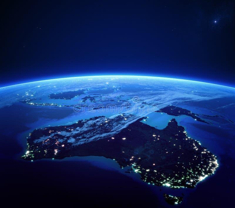 Australia z miastem zaświeca od przestrzeni przy nocą ilustracji