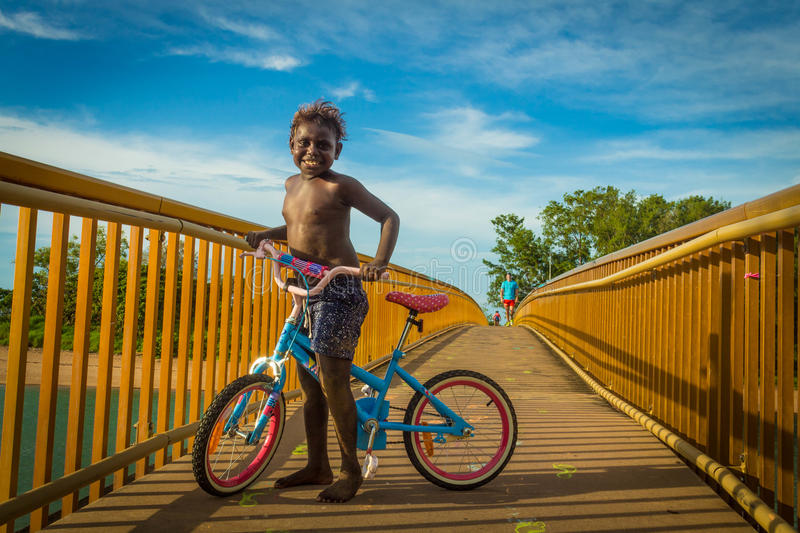 Australian aboriginal kid in a cycle. royalty free stock photos