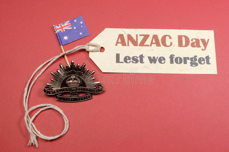 Australian ANZAC Day WW1 Rising Sun Hat Badge with flag and Lest We Forget message stock images