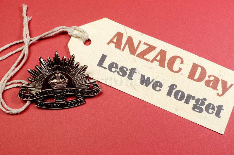 Australian ANZAC Day WW1 Rising Sun Hat Badge with Lest We Forget message stock image