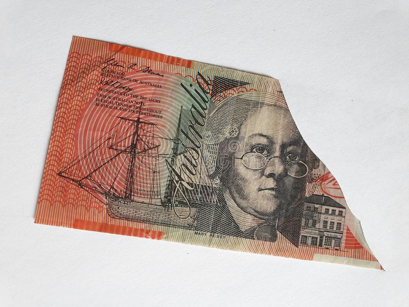 Australian banknote of twenty dollars on the broken sheet of paper. Commerce, exchange, trade, trading, value, buy, sell, profit, price, rate, cash, currency stock photography