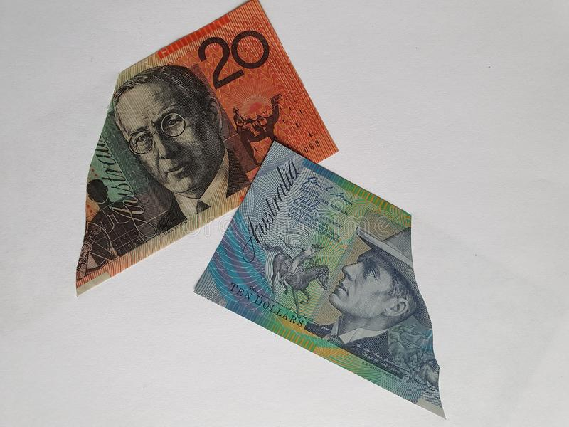 Australian banknotes of different denominations on the broken sheet of paper. Commerce, exchange, trade, trading, value, buy, sell, profit, price, rate, cash stock image