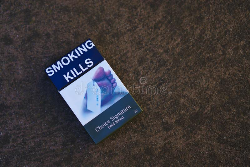 Australian Cigarette Pack with Smoking kills sign stock photos