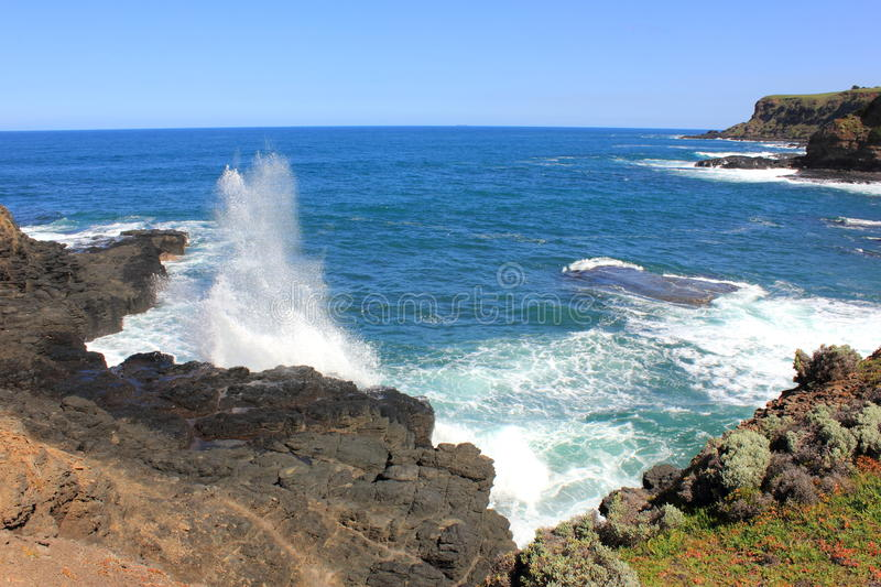 Australian coastline. Beautiful rocky australian coastline on a sunny summers day with blue seas and sky on the horizon stock image